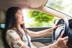 Asian girl driving a car Royalty Free Stock Photo