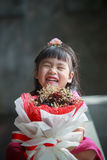 Asian girl with dry flower bouquet in hand laughing with happine Royalty Free Stock Images