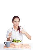Asian girl eat salad show thumbs up Stock Photos