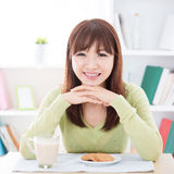 Asian girl eating breakfast stock image