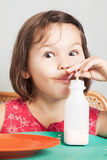 Asian girl eating a donut with milk. The asian girl eating a donut with milk Royalty Free Stock Images