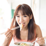 Asian girl eating dumplings stock image