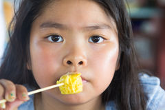 Asian girl eating dumplings Royalty Free Stock Photos