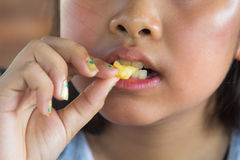 Asian girl eating French fries Royalty Free Stock Images