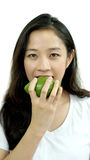 Asian girl eating fruit, avocado. Clean food, healthy and weight Stock Photos
