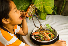 Asian girl eating her meal. Stock Images
