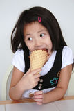 Asian girl eating ice cream cone royalty free stock images