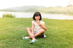 Asian girl eating ice cream royalty free stock photography