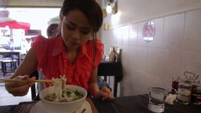 Asian girl eating noodle in a local restaurant, phnom penh Royalty Free Stock Photos