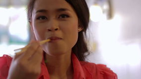 Asian girl eating noodle in a local restaurant, phnom penh stock footage
