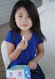 Asian girl eating popcorn royalty free stock photos