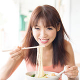 Asian girl eating ramen Stock Photography