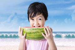 Asian girl eating slice of watermelon Royalty Free Stock Photography