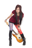 Asian girl with electric guitar Royalty Free Stock Photo