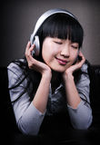 Asian Girl Enjoy Music with Hi-Fi Headphone Royalty Free Stock Image