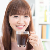 Asian girl enjoying coffee Stock Photography