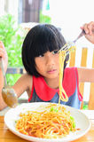 Asian girl enjoying her lunch with spaghetti. Stock Photos