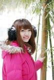 Asian girl enjoying the snow Royalty Free Stock Photography