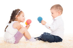 Asian girl and European boy playing with balls Stock Photos