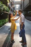 Asian girl and european guy on bangkok street stock photography