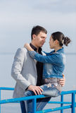 Asian girl and european guy on seashore Royalty Free Stock Photo