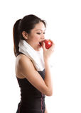 Asian girl exercise and eating apple Stock Image