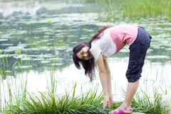 Asian girl exercise in park Stock Photo