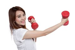 Asian girl exercise with red dumbbells and smile very happy Royalty Free Stock Images