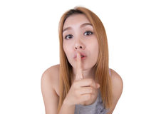 Asian girl expressing a desire for silence or secret. Royalty Free Stock Photography