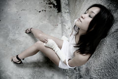 Asian girl with eyes closed. Beautiful sexy Asian girl resting with eyes closed Stock Photo