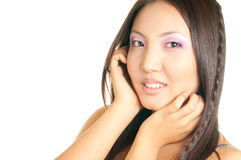 Asian girl face. Beautiful asian woman with bright makeup touching her face isolated on white background Stock Photography