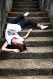 Asian girl fallen down steps. Asian girl fallen down some cement steps and unconscious Royalty Free Stock Images