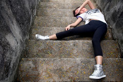 Asian girl fallen down steps Royalty Free Stock Photos
