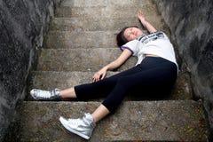 Asian girl fallen down steps. Asian girl fallen down cement steps unconscious Stock Images