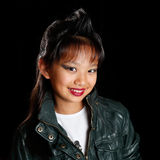 Asian girl with a fashionable hairstyle smiling Stock Image