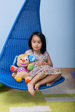 Asian girl with favourite bear. At home Stock Images