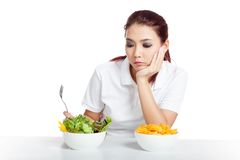 Asian girl fed up with crisps and salad Stock Photos