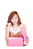 Asian girl fed up look at a gift box Royalty Free Stock Images