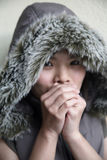 Asian girl feeling cold Royalty Free Stock Images