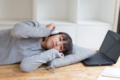 asian girl female teenager student lying and listening to music Royalty Free Stock Photography