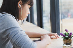 asian girl female teenager student wearing headphones and listen Stock Photo