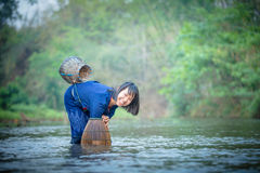 Asian girl fishing Stock Images
