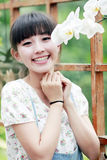 Asian girl with flower. Charming Asian girl with flower in the garden Stock Photo