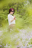 An Asian girl in the flower Royalty Free Stock Photo