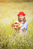 Asian girl with flower in the garden Royalty Free Stock Photography