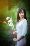 Asian girl with flower in the garden Stock Photos