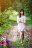 Asian girl with flower in the garden Royalty Free Stock Images