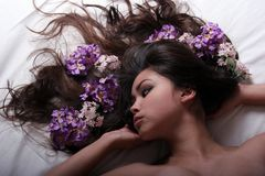 Asian girl with flowers. Beautiful long haired asian girl with flowers stock photo