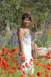 Asian girl and flowers Royalty Free Stock Photography