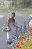 Asian girl and flowers Royalty Free Stock Photo
